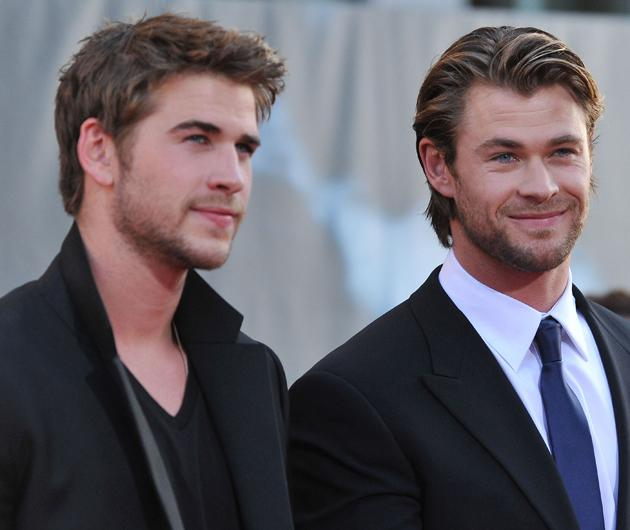 Chris Hemsworth and Liam Hemsworth photos: Anyone else feeling a little flushed after seeing this snap? Copyright [Getty]