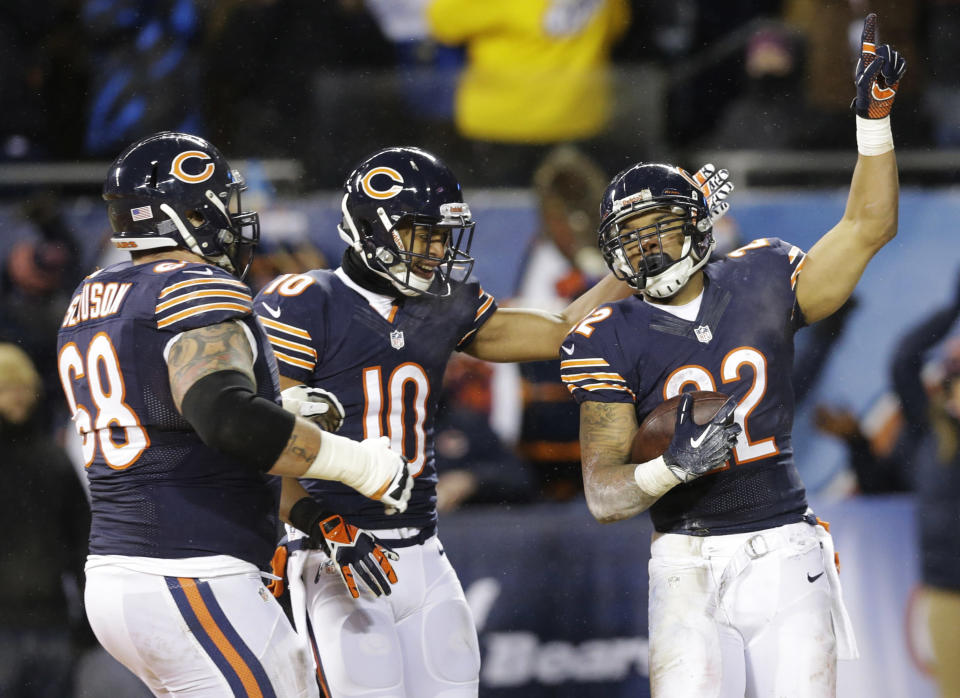 Chicago Bears running back Matt Forte (22) celebrates a 5-yard touchdown run with guard Matt Slauson (68) and wide receiver Marquess Wilson (10) during the second half of an NFL football game against the Green Bay Packers, Sunday, Dec. 29, 2013, in Chicago. (AP Photo/Nam Y. Huh)