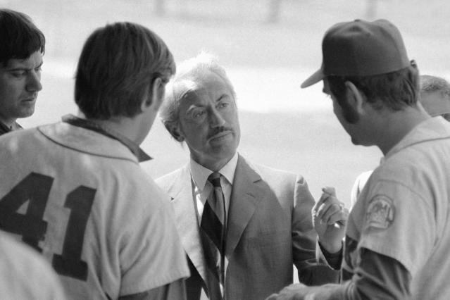 FILE - This March 11, 1972, file photo shows Marvin Miller, executive director of the Major League Players Association, talking to New York Mets' Tom Seaver (41), and Ed Kranepool, in St. Petersburg, Fla. Miller, the union leader who revolutionized baseball by empowering players to negotiate multimillion-dollar contracts and to play for teams of their own choosing, was elected to baseball's Hall of Fame on Sunday, Dec. 8, 2019. (AP Photo/File)