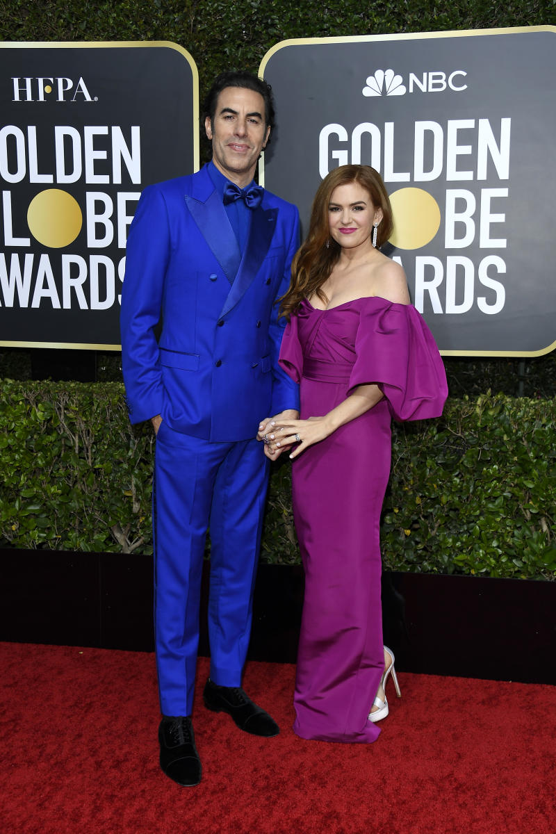 Isla Fisher and Sacha Baron Cohen at the Golden Globes red carpet