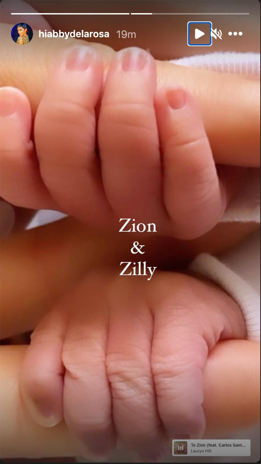 """<p>De La Rosa also shared a photo of the babies' hands holding onto her fingers on her Instagram Stories, writing, """"Zion & Zilly.""""</p> <p>The <a href=""""https://people.com/parents/nick-cannon-abby-de-la-rosa-welcome-twin-boys-zion-zillion/"""" rel=""""nofollow noopener"""" target=""""_blank"""" data-ylk=""""slk:new mom announced Cannon was her babies' father"""" class=""""link rapid-noclick-resp"""">new mom announced Cannon was her babies' father</a> on Instagram in April when she shared photos from a maternity shoot that featured the <a href=""""https://people.com/tv/the-masked-singer-revealed-so-far/"""" rel=""""nofollow noopener"""" target=""""_blank"""" data-ylk=""""slk:Masked Singer"""" class=""""link rapid-noclick-resp""""><em>Masked Singer</em></a> host.</p> <p>""""Your Dad & I will always be here for you both; in complete unison and support. No matter what this world may throw your way, know that forgiveness is key and what is for you - is for YOU! You both are already so loved and we can't wait to meet you both,"""" De La Rosa wrote at the time. That post has since been deleted from her Instagram page.</p>"""
