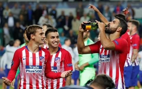 Atletico Madrid's Diego Costa and Antoine Griezmann celebrate after the match - Credit: Reuters