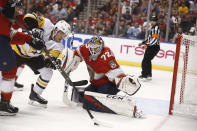 Florida Panthers goaltender Sergei Bobrovsky (72) defends the net against Pittsburgh Penguins center Dominik Simon (12) during the second period of an NHL hockey game Tuesday, Oct. 22, 2019, in Sunrise, Fla. (AP Photo/Brynn Anderson)