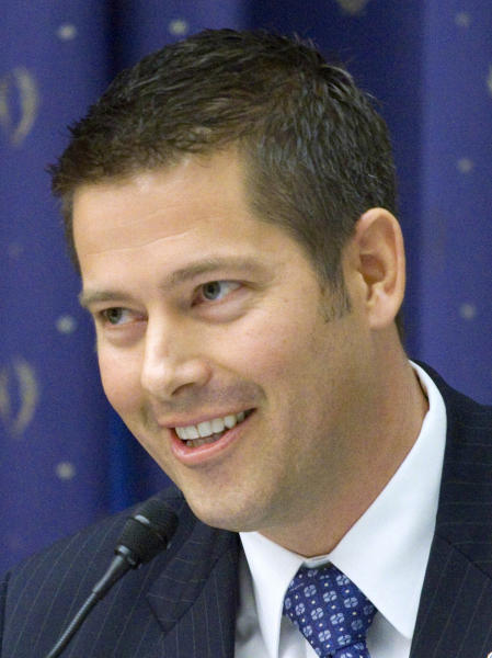 """FILE - In this March 16, 2011 file photo, Rep. Sean Duffy, R-Wis. takes part in a hearing on Capitol Hill in Washington. Missouri congressman and Republican Senate candidate Todd Akin's comments on rape are playing a role in more than dozen House races in battleground states _ particularly those in which the incumbents joined Akin last year in co-sponsoring a resolution that would have redefined rape as """"forcible rape."""" Duffy's Democratic challenger, Pat Kreitlow, had made Duffy's support for legislation defining """"forcible rape"""" that Akin supported an issue even before Akin's comments. (AP Photo/Harry Hamburg, File)"""