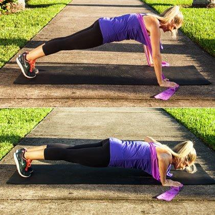 """<p><em>Targets chest, arms, abs, back</em></p> <ul><li>Grab one end of the resistance band in each hand and stretch it across your upper back/shoulders (the band should be under your armpits).</li> <li>Get into push-up position with your feet together, holding the ends of the band in place with your hands [top photo].</li> <li>Lower your body to perform a <a href=""""https://admin.web.shape.com/fitness/workouts/30-day-push-up-challenge"""" target=""""_blank"""">full push-up</a> [bottom photo].</li> <li><strong>Make this resistand band exercise for abs easier:</strong> If full push-ups are too tough, modify with push-ups on your knees. </li> <li><strong>Make this resistand band exercise for abs harder:</strong> Increase the resistance by shortening the band (hold more of it under your hands). If you're not working with a flat band, you may want to drape a towel over your upper back to avoid any """"band burn.""""</li> </ul><p><strong>Do 15 reps.</strong></p>"""