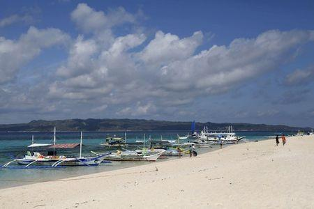 Duterte threatens to shut top tourist island Boracay because it is 'cesspool'