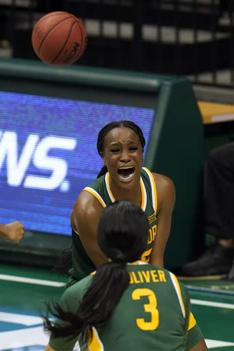 Baylor center Queen Egbo celebrates with guard Trinity Oliver (3) after scoring against the South Florida during the second half of an NCAA women's college basketball game Tuesday, Dec. 1, 2020, in Tampa, Fla. (AP Photo/Chris O'Meara)