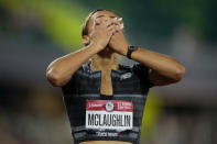 Sydney McLaughlin reacts after setting a new world record in the finals of the women's 400-meter hurdles at the U.S. Olympic Track and Field Trials Sunday, June 27, 2021, in Eugene, Ore. (AP Photo/Ashley Landis)