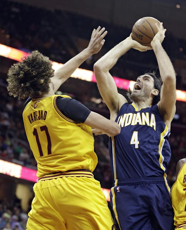 Indiana Pacers' Luis Scola (4), of Argentina, shoots over Cleveland Cavaliers' Anderson Varejao (17), of Brazil, during the fourth quarter of an NBA basketball game Sunday, Jan. 5, 2014, in Cleveland. The Pacers won 82-78. (AP Photo/Tony Dejak)