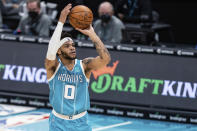 Charlotte Hornets forward Miles Bridges shoots against the Utah Jazz during the first half of an NBA basketball game in Charlotte, N.C., Friday, Feb. 5, 2021. (AP Photo/Jacob Kupferman)