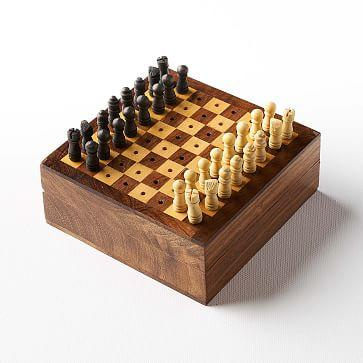 "<h2>Travel Chess Set<br></h2><br>If you've always wanted to invest in a chess set to display, knowing full well you will probably never play it (same), this 4inch rosewood set is for you. <br><br><strong>West Elm</strong> Travel Chess Game, $, available at <a href=""https://go.skimresources.com/?id=30283X879131&url=https%3A%2F%2Fwww.westelm.com%2Fproducts%2Ftravel-chess-game-d9165%2F"" rel=""nofollow noopener"" target=""_blank"" data-ylk=""slk:West Elm"" class=""link rapid-noclick-resp"">West Elm</a>"