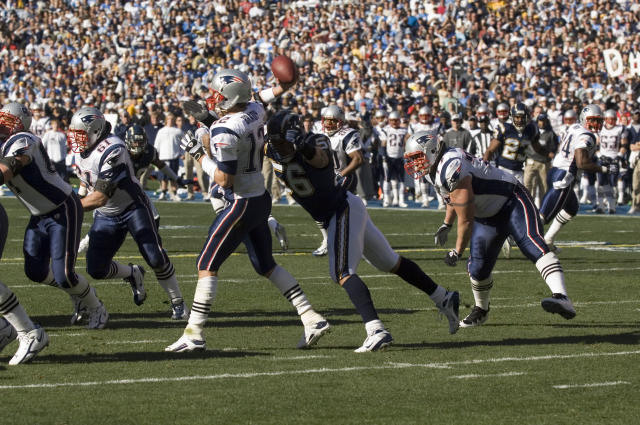 Shawne Merriman #56 on the San Diego Chargers tackles Tom Brady #12 of the New England Patriots on Jan. 14, 2007 during the AFC Playoffs in San Diego, Calif. (John Cordes for SN)