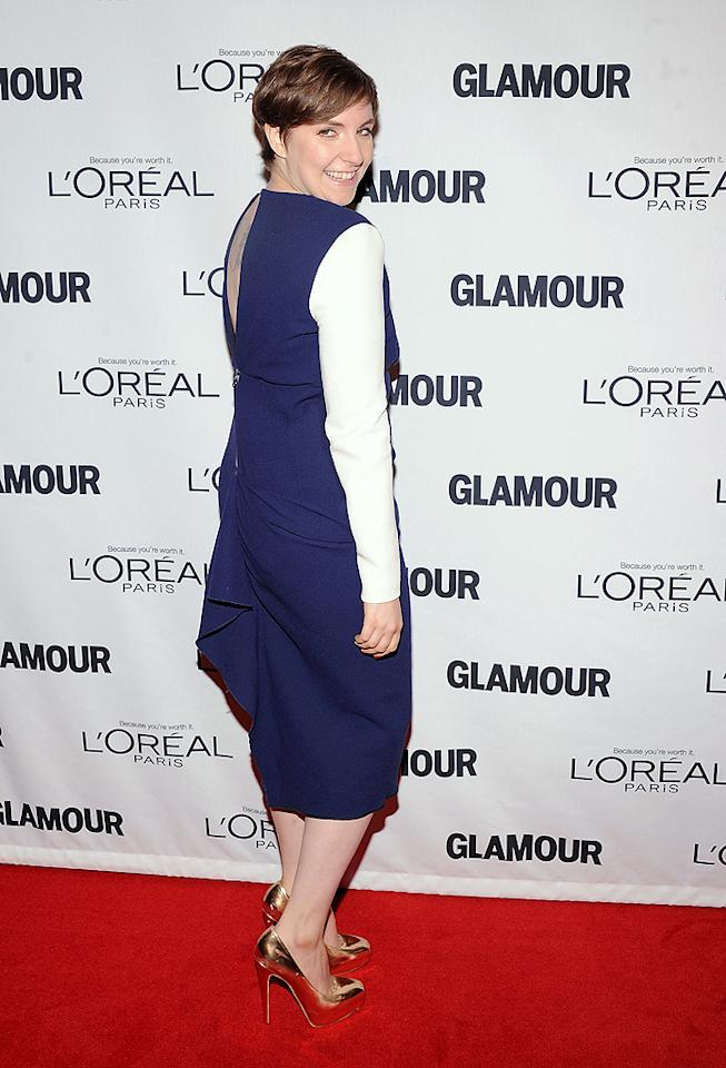 """Lena Dunham, current TV darling and the mind behind HBO's smash hit """"Girls,"""" showed off her killer curves in a Roksanda Ilincic dress and snapped up a Glamour award for her contributions to entertainment. (11/12/12)"""