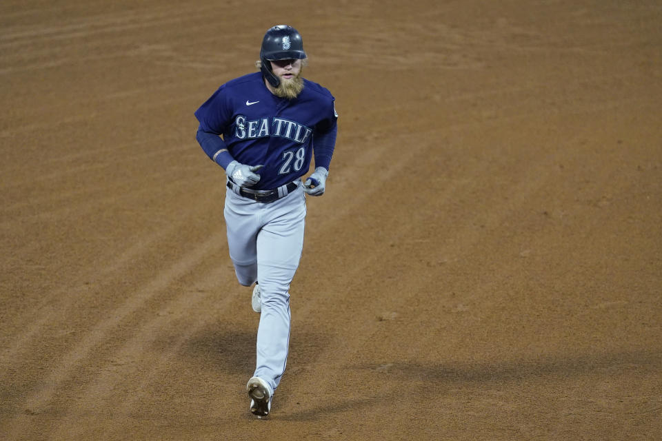 Seattle Mariners designated hitter Jake Fraley (28) runs the bases after hitting a grand slam home run during the fourth inning of a baseball game against the Los Angeles Angels Saturday, June 5, 2021, in Anaheim, Calif. Mitch Haniger, Ty France, and Taylor Trammell also scored. (AP Photo/Ashley Landis)