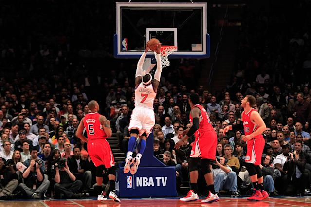 NEW YORK, NY - APRIL 25: Carmelo Anthony #7 of the New York Knicks dunks the ball against the Los Angeles Clippers at Madison Square Garden on April 25, 2012 in New York City. NOTE TO USER: User expressly acknowledges and agrees that, by downloading and/or using this Photograph, user is consenting to the terms and conditions of the Getty Images License Agreement. (Photo by Chris Trotman/Getty Images)