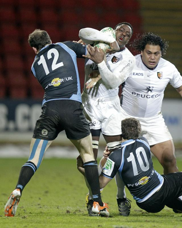 Glasgow Warriors' Graeme Morrison (L) and Ruaridh Jackson (donw - R) tackles Toulouse's Yannick Nyanga (2nd L) during their Heineken Cup, pool six, rugby union match at Firhill Stadium in Glasgow on December 10, 2010. AFP PHOTO/GRAHAM STUART (Photo credit should read GRAHAM STUART/AFP/Getty Images)