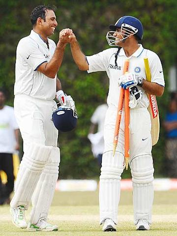 VVS Laxman (R) and Virender Sehwag (L) leave the grounds with stumps after their victory following the fifth and final day of the third Test match between Sri Lanka and India at The P Sara Oval International Cricket Stadium in Colombo. (Lakruwan Wanniarachchi/AFP/Getty Images)