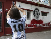 Fans of Argentinian football legend Diego Maradona gather outside Argentinos Junior's Diego Armando Maradona Stadium to mourn his dead in La Paternal neighbourhood, Buenos Aires, on November 25, 2020, on the day of his death. (Photo by ALEJANDRO PAGNI / AFP) (Photo by ALEJANDRO PAGNI/AFP via Getty Images)