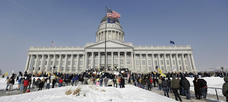 Gun-rights advocates gather outside the Utah Capitol during the National Gun Appreciation Day Rally Saturday, Jan. 19, 2013, in Salt Lake City. Gun owners and Second Amendment advocates rallied in state capitals nationwide Saturday, days after President Barack Obama unveiled a sweeping package of federal gun-control proposals. (AP Photo/Rick Bowmer)