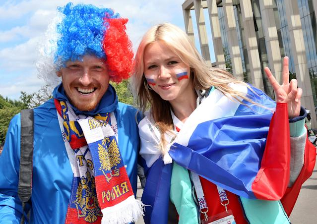<p>National pride: Russian supporters show off their country's colours in Moscow ahead of the first fixture. (EPA) </p>