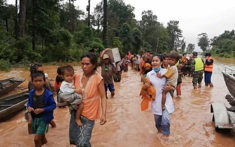 A still from a video posted by Attapeu Today's Facebook page showing people evacuating flooded villages after a Laos dam collapse - Credit: Attapeu Today