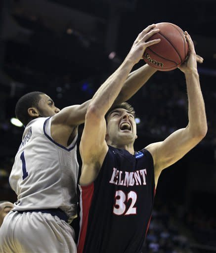 Belmont's Scott Saunders (32) is fouled by Georgetown's Hollis Thompson (1) while jumping for a rebound during the second half of an NCAA men's college basketball tournament second-round game in Columbus, Ohio, Friday, March 16, 2012. Georgetown won 74-59. (AP Photo/Tony Dejak)