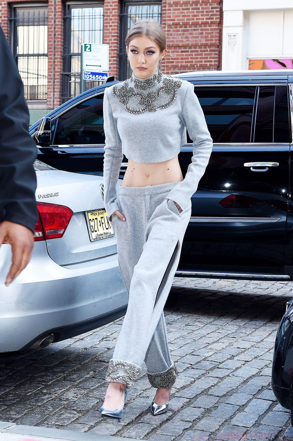 """<p>There are three things all items in Gigi's closet <em>must </em>have: massive thigh slits, a subtle anthleisure vibe, and some kind of eye-grabbing detail. This super fancy sweatsuit checks off all three. But that level of slayage doesn't come cheap – the Sally LaPointe set costs <a href=""""http://www.elle.com/fashion/celebrity-style/news/a44531/gigi-hadid-sally-lapointe-sweats/?src=socialflowTW"""" rel=""""nofollow noopener"""" target=""""_blank"""" data-ylk=""""slk:$4,100"""" class=""""link rapid-noclick-resp"""">$4,100</a>. 😳</p>"""