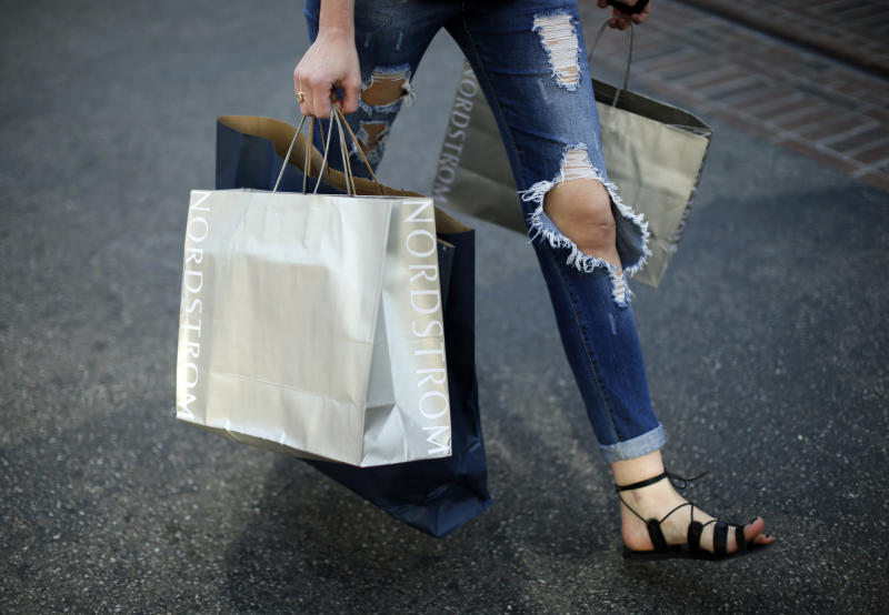 A woman carries Nordstrom shopping bags at The Grove mall in Los Angeles November 26, 2013. This year, Black Friday starts earlier than ever, with some retailers opening early on Thanksgiving evening. About 140 million people were expected to shop over the four-day weekend, according to the National Retail Federation. REUTERS/Lucy Nicholson (UNITED STATES - Tags: BUSINESS)