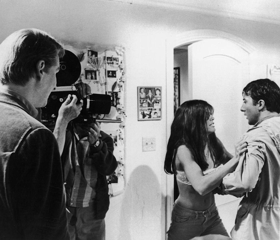 <p>Dustin Hoffman and Katharine Ross film a scene in The Graduate, as director Mike Nichols watches behind the camera. </p>