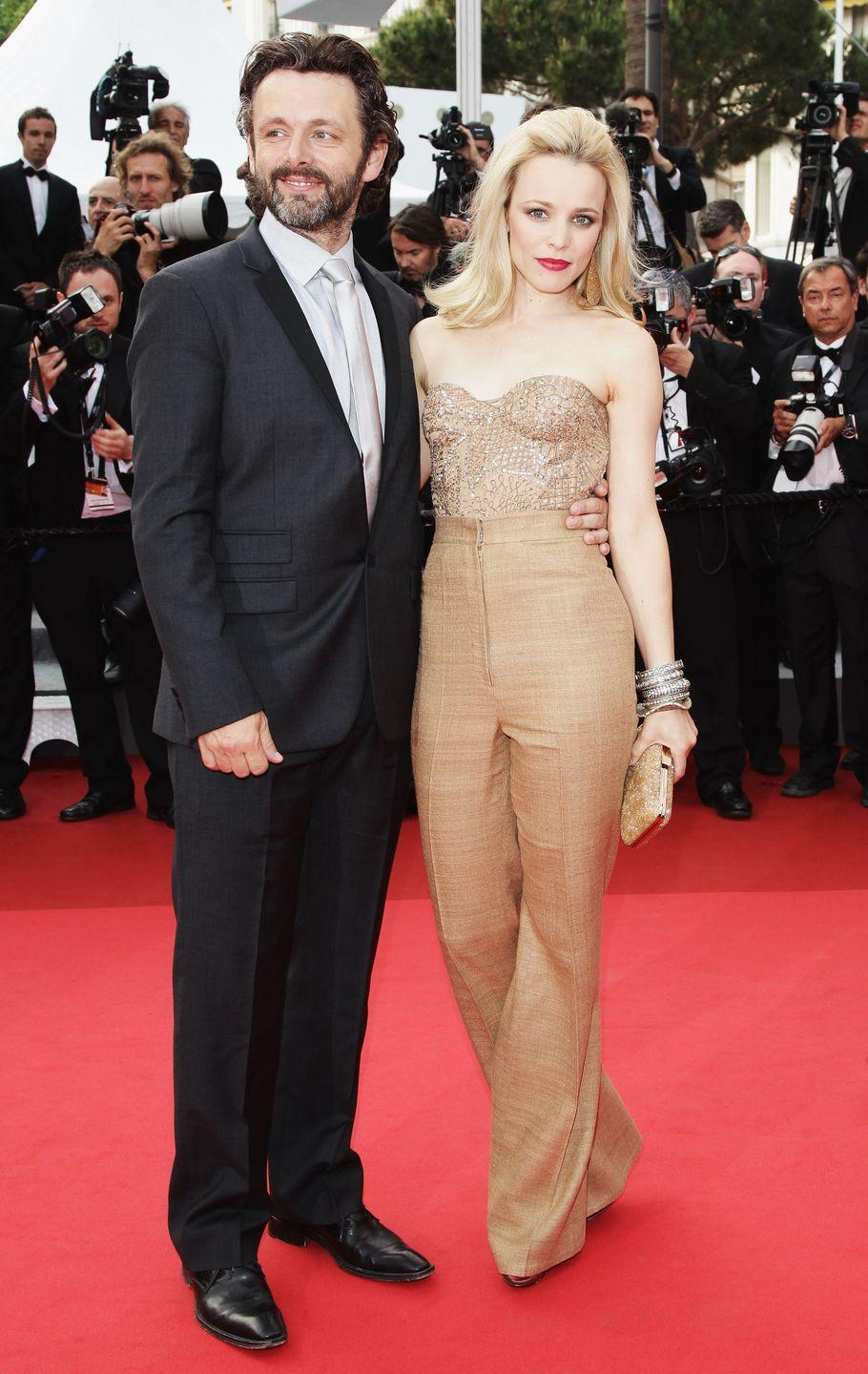"""<p>Oh, on-set romances. These two met while filming Woody Allen's <em>Midnight in Paris</em> and confirmed it on the red carpet at the 2011 Cannes Film Festival. Before breaking up in 2013, the couple never went too long without seeing each other.</p><p>""""Michael and I never spend more than three weeks apart -- we rack up a lot of air miles -- but you have to be quite adaptable in this business whether you are in a relationship or not,"""" <em>The Notebook</em> star<a href=""""https://www.glamour.com/story/rachel-mcadams-and-michael-she"""" rel=""""nofollow noopener"""" target=""""_blank"""" data-ylk=""""slk:said."""" class=""""link rapid-noclick-resp""""> said.</a></p>"""
