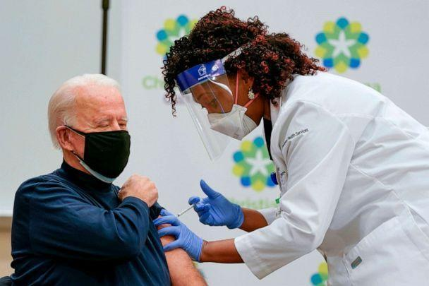 PHOTO: President Joe Biden receives a Covid-19 vaccination from Tabe Masa, Nurse Practitioner and Head of Employee Health Services, at the Christiana Care campus in Newark, Delaware, Dec. 21, 2020. (Alex Edelman/AFP via Getty Images, FILE)