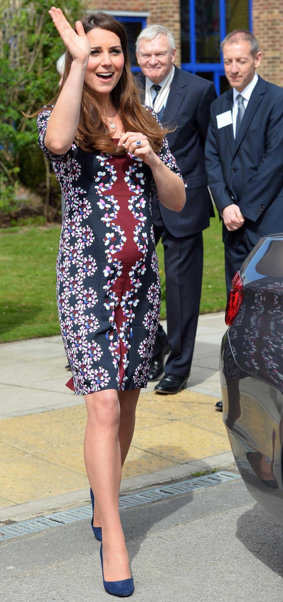 <p>Kate turned up to a school event in a printed shift dress by Erdem. Navy suede Stuart Weitzman pumps and a matching clutch topped off the look.</p><p><i>[Photo: PA]</i></p>