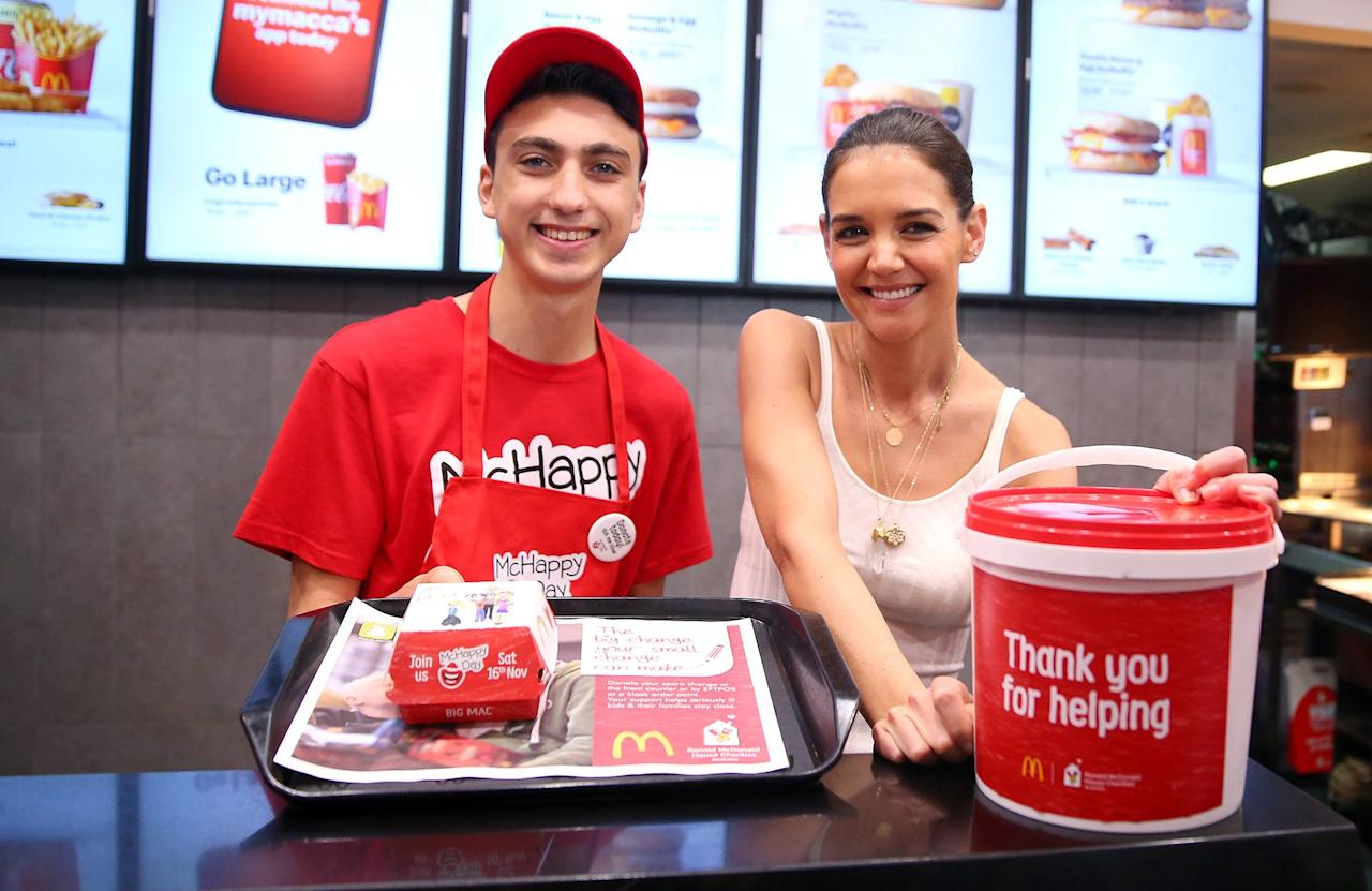 Katie Holmes celebrates McHappy Day at a McDonald's in Sydney on Saturday as she continues her visit Down Under with Ronald McDonald charities.