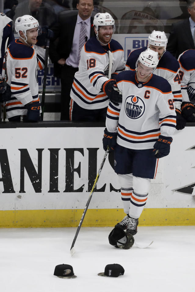 Edmonton Oilers center Connor McDavid celebrates his hat trick against the Anaheim Ducks during the third period of an NHL hockey game in Anaheim, Calif., Sunday, Nov. 10, 2019. (AP Photo/Chris Carlson)