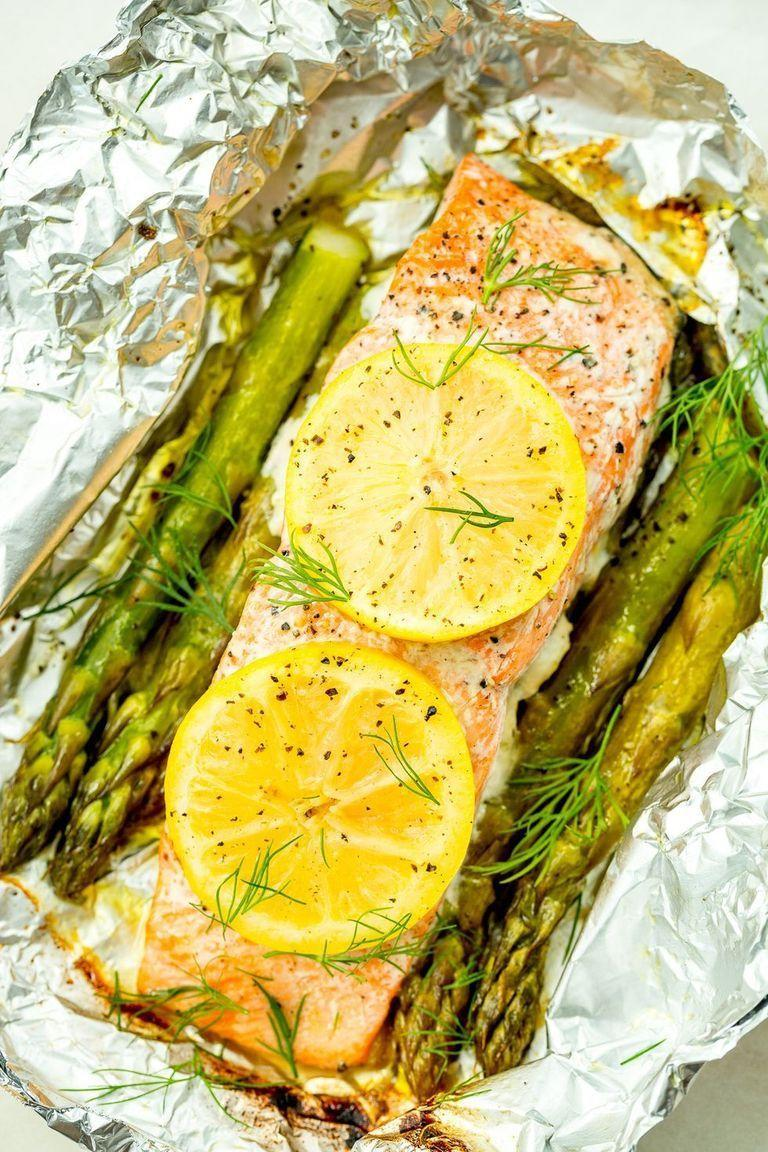 """<p>These super-fresh salmon grill packs make clean-up a breeze.</p><p>Get the <a href=""""https://www.delish.com/uk/cooking/recipes/a29205113/foil-pack-grilled-salmon-with-lemony-asparagus-recipe/"""" rel=""""nofollow noopener"""" target=""""_blank"""" data-ylk=""""slk:Foil Pack Grilled Salmon with Lemony Asparagus"""" class=""""link rapid-noclick-resp"""">Foil Pack Grilled Salmon with Lemony Asparagus </a>recipe. </p>"""