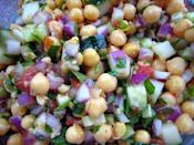 <p><b>Chickpea salad:</b></p><p> Chickpeas are a good source of protein. To make this salad, pressure cook 1 cup chickpeas (soaked overnight) till they are soft but firm. Add 1 boiled & cubed potato, 1 chopped tomato & onion to the chickpeas. Finely chop one green chili & add to the mix. Make a dressing with 1 tsp extra virgin olive oil, chaat masala, pinch of pepper powder, 1 tsp lemon juice & salt to taste. Mix into the salad & serve immediately or refrigerate for sometime. <br></p>
