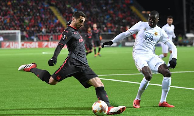 Henrikh Mkhitaryan crosses the ball under pressure from Ken Sema of Östersund during the Europa League last-32 first-leg tie in Sweden.