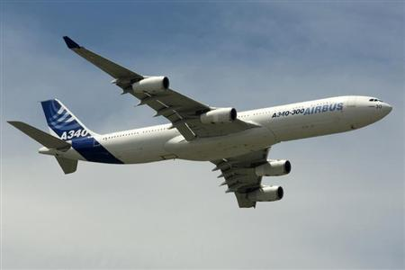 An Airbus A340-300 takes part in a flying display during the 48th Paris Air Show at the Le Bourget airport near Paris