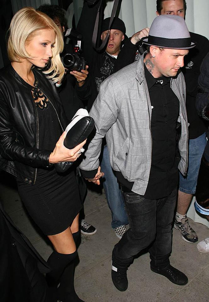"""Paris Hilton and Benji Madden may be facing some legal problems of their own. Benji was in such a rush to leave Foxtail nightclub Friday morning that he allegedly drove over a paparazzo's foot and kept going. The paparazzo has filed a hit and run report against the Good Charlotte guitarist. Octavio Vera Jr./<a href=""""http://www.splashnewsonline.com"""" target=""""new"""">Splash News</a> - April 24, 2008"""