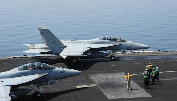 The USS George H.W. Bush aircraft carrier is based in the Gulf and its warplanes could be used to launch attacks against Islamic State militants based in Iraq and Syria (AFP Photo/Joshua Card)