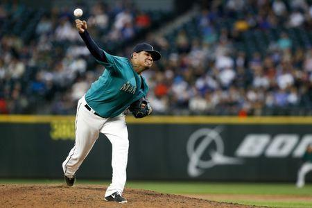 Jul 6, 2018; Seattle, WA, USA; Seattle Mariners starting pitcher Felix Hernandez (34) pitches against the Colorado Rockies during the fifth inning at Safeco Field. Mandatory Credit: Joe Nicholson-USA TODAY Sports
