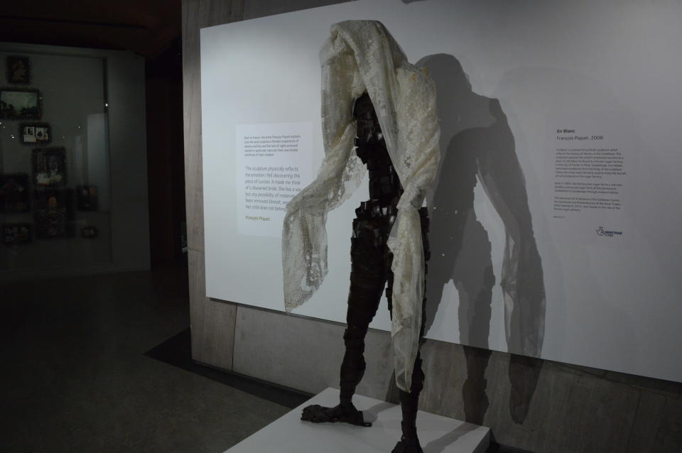 """In this Nov. 24, 2019 photo, a sculpture entitled, """"En Blanc,"""" by French artist Francois Piquet, which tackles the themes of women in slavery in the Caribbean, is displayed at the International Slavery Museum in Liverpool, England. The museum seeks to tell the story of the enslavement of people from Africa and how the British city benefited from human bondage. (AP Photo/Russell Contreras)"""