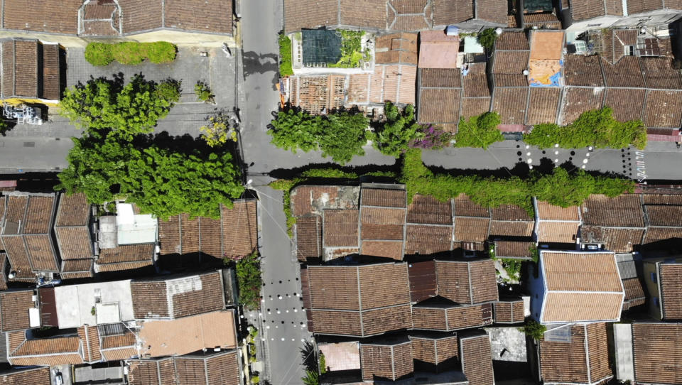 An aerial photo shows quiet streets during social distancing in Hoi An, Vietnam, Friday, July 31, 2020. The old town, Vietnam's top tourist attraction, starts two weeks of social distancing on Friday morning in an attempt to contain the spread of the coronavirus. (AP Photo/Hieu Dinh)