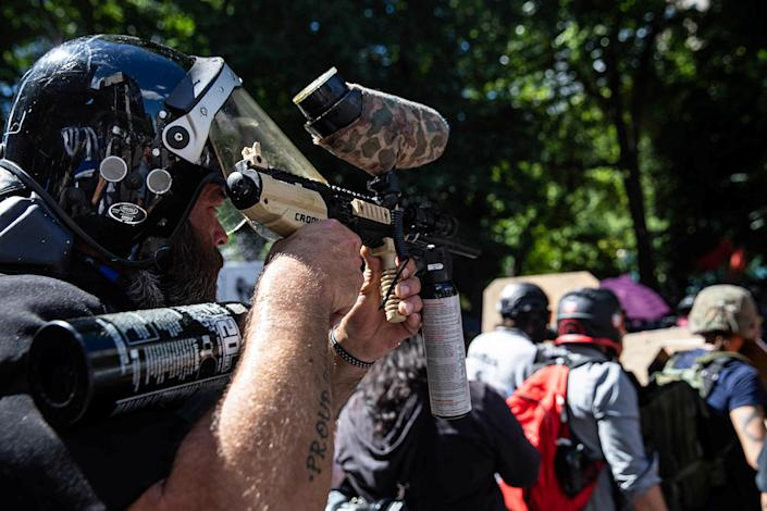 Alan Swinney uses a paintball gun at a protest against police brutality in Portland. (Maranie Staab/Reuters)