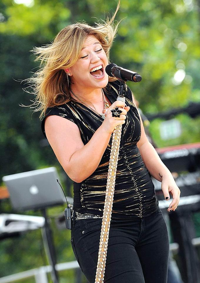 """Kelly Clarkson rocks out on """"Good Morning America"""" at Rumsey Playfield in Central Park. Dimitrios Kambouris/<a href=""""http://www.wireimage.com"""" target=""""new"""">WireImage.com</a> - July 31, 2009"""