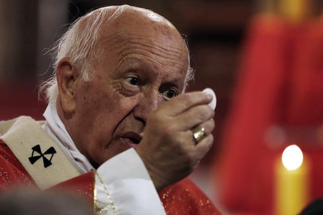 FILE - In this May 18, 2018 file photo, the archbishop of Santiago, Ricardo Ezzati, gives his first mass after returning from the Vatican, in Santiago. Pope Francis has on Saturday, March 23, 2019 replaced Cardinal Ricardo Ezzati, the embattled archbishop of Santiago, Chile, after he became embroiled in the country's spiraling sex abuse and cover-up scandal. Francis has accepted Ezzati's resignation and named a temporary replacement to govern Chile's most important archdiocese: the current bishop of Copiapo, Monsignor Celestino Aos Braco. (AP Photo/ Luis Hidalgo, File)