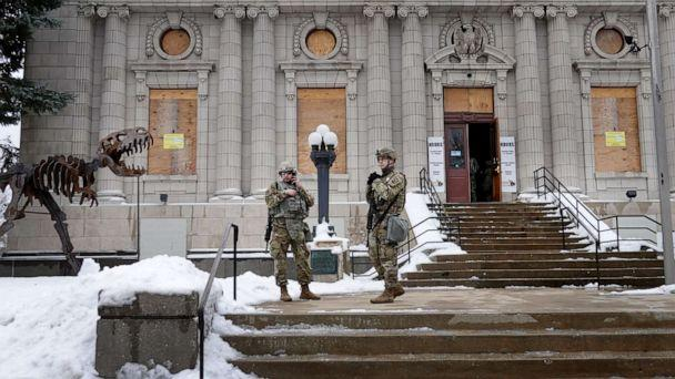 PHOTO: National guard troops stand guard near of the Kenosha County Courthouse as they wait for an announcement from the Kenosha district attorney on whether charges would be filed in the shooting of Jacob Blake, Jan. 5, 2021, in Kenosha, Wis. (Scott Olson/Getty Images)