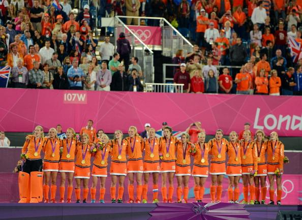 LONDON, ENGLAND - AUGUST 10:  Team Netherlands celebrate with their gold medals on the podium during the medal ceremony for the Women's Hockey on Day 14 of the London 2012 Olympic Games at Hockey Centre on August 10, 2012 in London, England.  (Photo by Mike Hewitt/Getty Images)