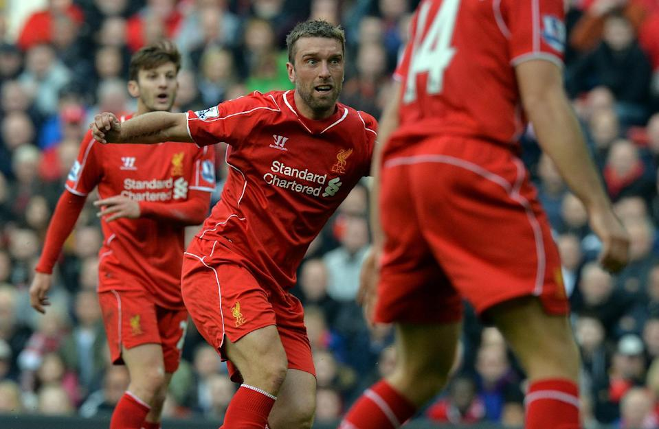Liverpool's Rickie Lambert watches his shot during their English Premier League match against West Bromwich Albion, at Anfield in Liverpool, north-west England, on October 4, 2014 (AFP Photo/Paul Ellis)