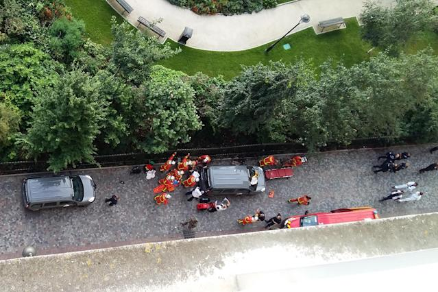 <p>Officials and rescuers gather near vehicles after a car slammed into soldiers on patrol in Levallois-Perret, outside Paris on August 9, 2017 injuring six, two of them seriously, police in the French capital said. (Photo: Thierry Chappe/AFP/Getty Images) </p>